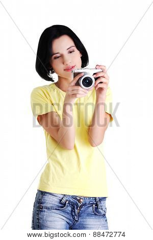 Young student woman with a photo camera.