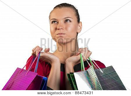 Angry lady handing bags narrowing her eyes