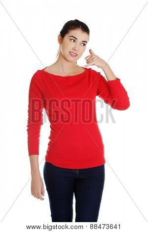 Woman making a call me gesture.