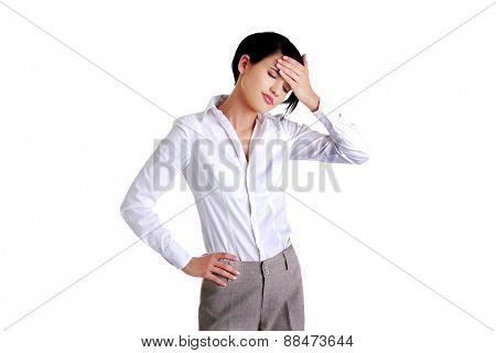 Young businesswoman suffering a headache.