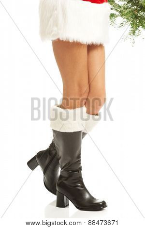 Female legs in santa high boots