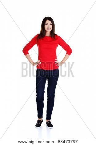 Full length woman posing with hands on hips.