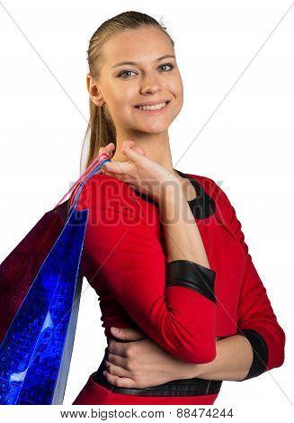 Woman with teeth smile handing bags