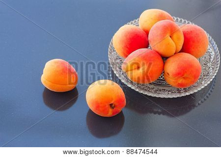 Fresh Apricots On The Mirror Background