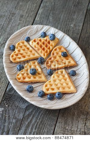 Waffles And  Blueberries  On A Wooden Background