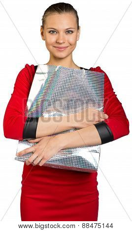 Woman with smile holding shopping bag