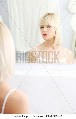 Beautiful woman viewing herself in the mirror.
