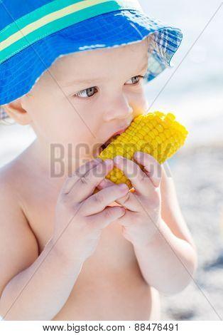 Toddler Cute Boy Eating Boiled Corn