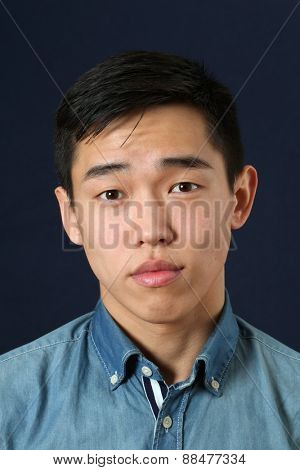 Romantic young Asian man looking at camera