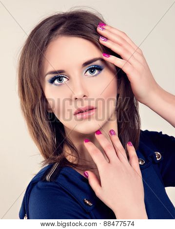 Beautiful Young Woman with Blue Eyes, Long Lashes and Pink nails