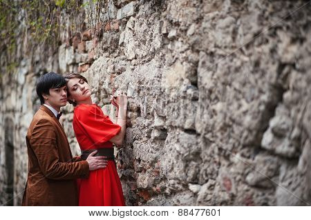 Young Beautiful Couple At The Wall