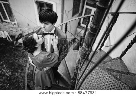 Young Beautiful Couple Near Old House At The Stairs