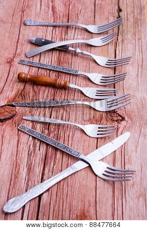 Array Of Rustic Forks And A Single Knife