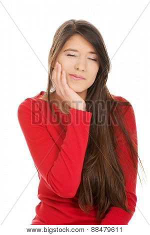Young student woman suffering from tootache.