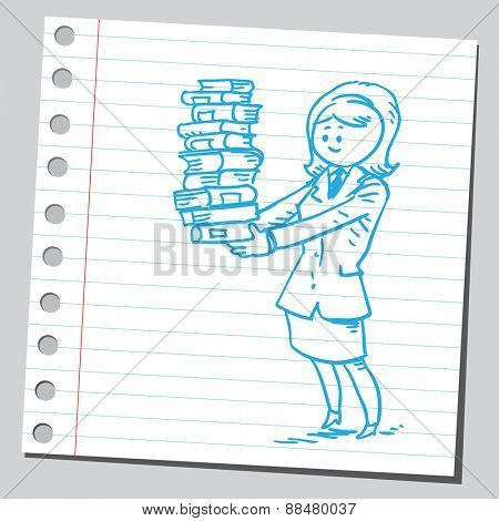Businesswoman holding a pile of books