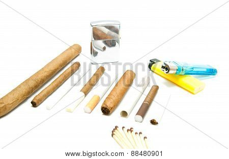 Matches, Cigarettes And Lighters On White
