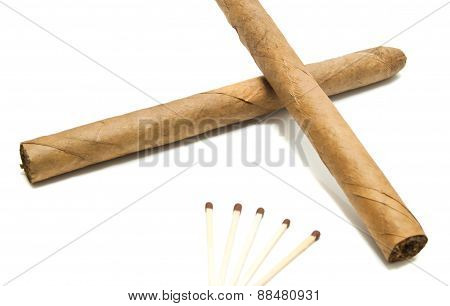 Two Cigars And Matches On White