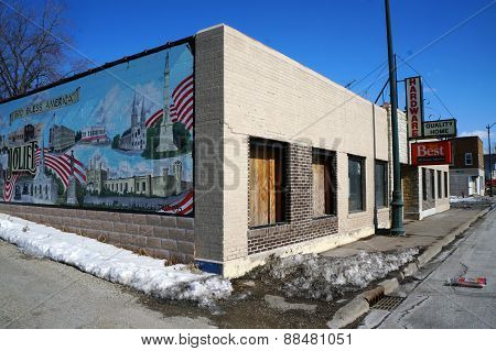 A Boarded-Up Hardware Store with a Patriotic Mural on its Wall