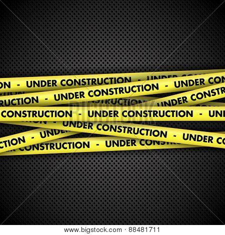 Under construction warning tape on perforated metal background
