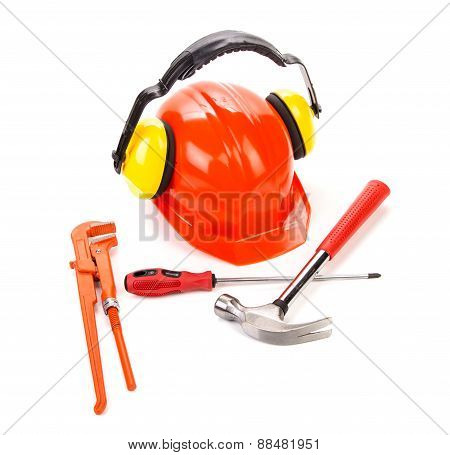 Red hard hat with instruments.