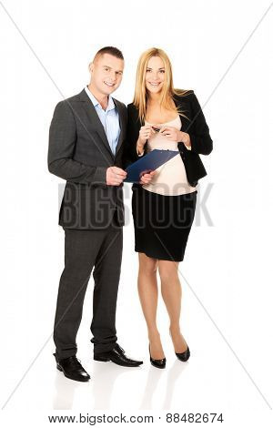 Working pregnant woman with her partner