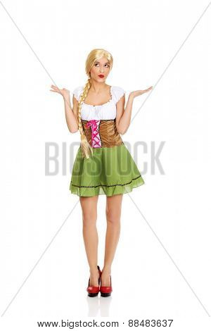 Woman wearing traditional Bavarian dress with open hands.