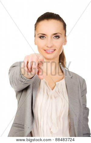 Beautiful confident businesswoman pointing on you.