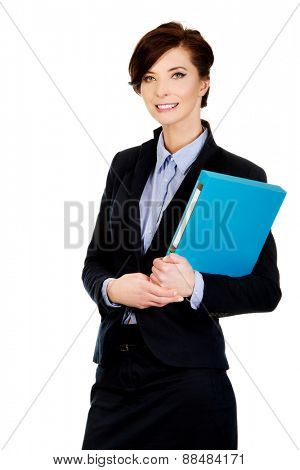 Beautiful businesswoman holding a binder.