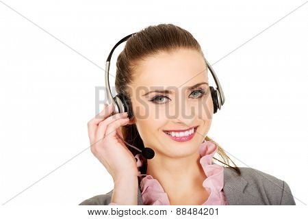 Beautiful smiling call center woman in headset.