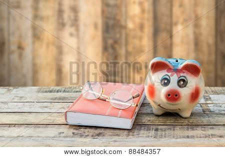Notebook Glasses And Coffee Cup On Wooden Table And Blurred Background