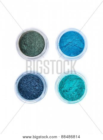 Top view of mineral eye shadows in pastel colors, top view isolated on white background