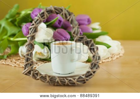 Tulips On The Table With Cup Of Caffee