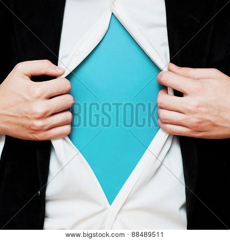 Businessman showing a copy space under his shirt
