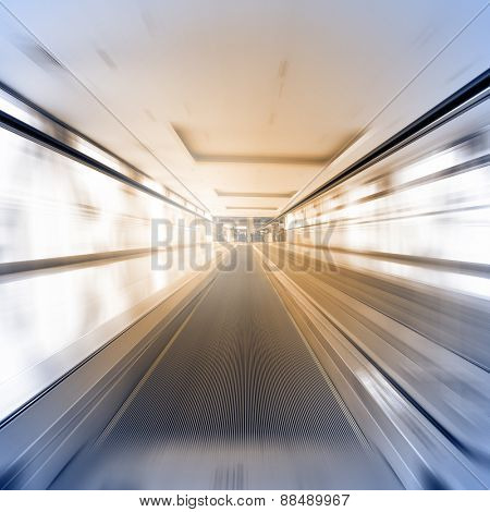 Escalator in motion - abstract business and architectural background