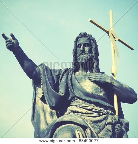 Jesus with cross at Charles bridge in Prague. Instagram style filtred image