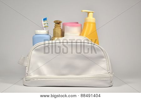 Different Containers In Cosmetic Bag