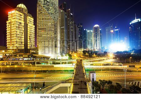 Illuminated skyline and buildings in modern city at night