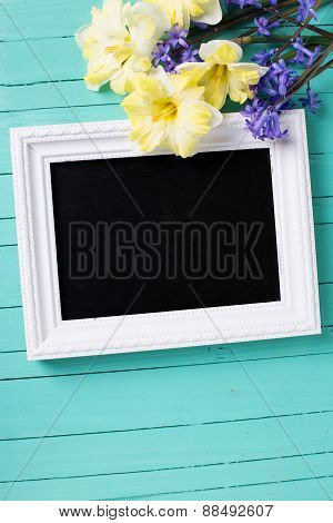 Fresh Yellow And Blue Flowers And Empty Blackboard On Wooden Background