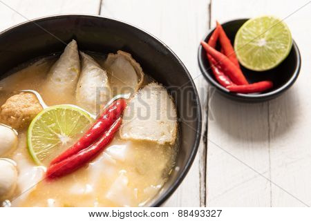 Bowl Of Spicy Soup With Noodles And Vegetables For A Delicious Appetizer And Surrounded By Fresh Ing