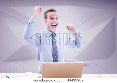 Businessman cheering against abstract grey room