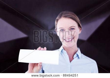 Businesswoman showing her business card against abstract black room