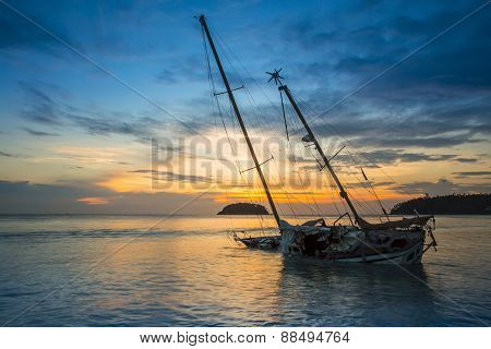 Old Fishing Boat Stranded On A Beach In Sunny Day