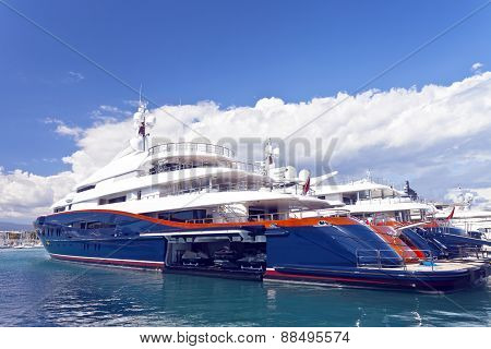 luxury Mega super yachts docked in harbour with jet ski inside