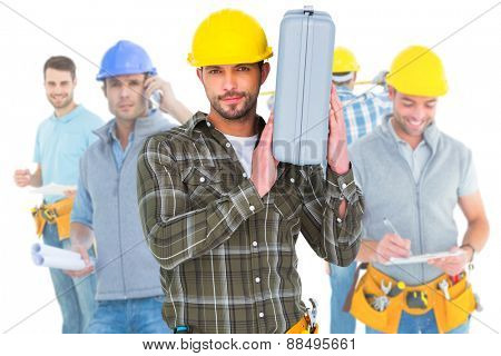 Composite image of repairman holding toolbox