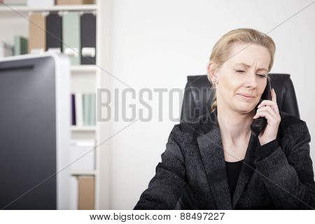 Serious Office Woman Chatting To Someone On Phone