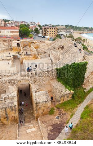 The Historical Amphitheater Of Tarragona With Tourists