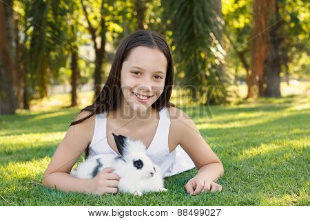 Cute Beautiful Laughing Teen Girl With White- Black Baby Rabbit