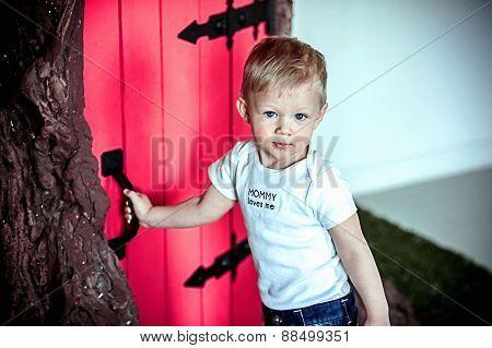 little boy in red door
