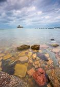 pic of hitler  - Beautiful view on Baltic rocky coast with old military buildings from world war II and wooden breakwaters - JPG
