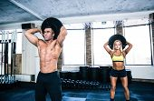 picture of gym workout  - Muscular man and fit woman workout at crossfit gym - JPG